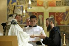 Br. Benedict Mary receives the Rule of St. Benedict after professing simple vows.