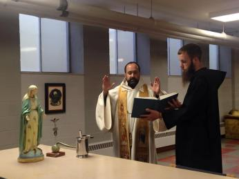 Fr. Jay Kythe, OSB, blesses our new statue and old vexillum